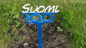 Suomi 100 puun istutusmerkki