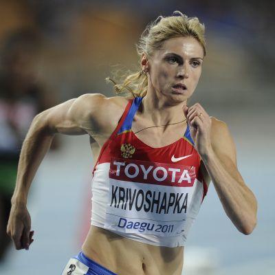 Antonina Krivoshapka juoksee.