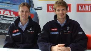 Timo Rautiainen och Marcus Grönholm i Helsingfors hösten 2002.