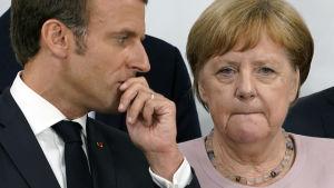 Frankrikes president Emmanuel Macron och Tysklands förbundskansler Angela Merkel fick arbeta hårt för klimattexten i slutdeklarationen