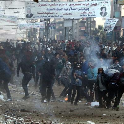 Anhängare till Muslimska brödraskapet demonstrerar i Kairo år i januari 2014.