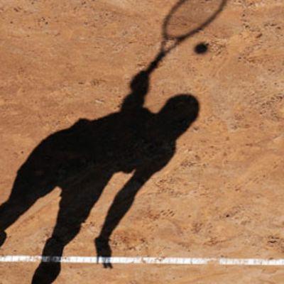 Tennispelaajan varjo