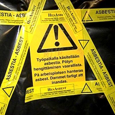 Asbestivaroituskyltti.