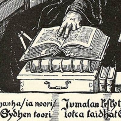 """Agricolan sormet kirjalla sekä teksti """"Oppe nyt wanha ia noori Jumalan keskyt ia mielen, joilla ompi Sydhen toori, jotca taidhat Somen kielen"""