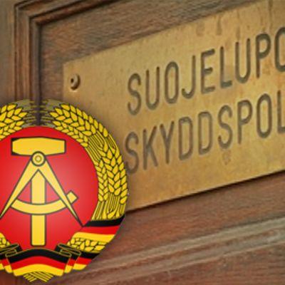 Suojelupoliisin ovi ja entisen DDR:n merkki.