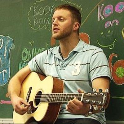 Koop performing at a school.
