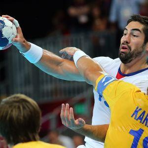 Frankrike och Nicola Karabatic firar OS-guld i handboll