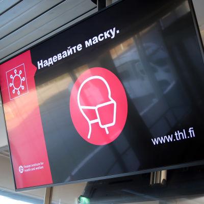Opaste kehottaa venäjäksi käyttämään maskia