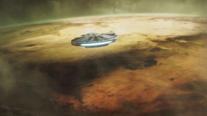 Rymdskeppet Millennium Falcom flyger ovanför en rödbrun planet.