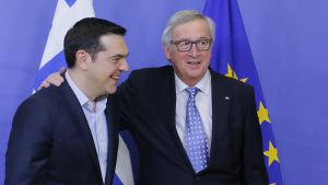 Greklands premiärminister Alexis Tsipras och EU-kommissionens ordförande Jean-Claude Juncker inför kommissionens möte i Bryssel den 17 februari.