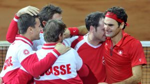 Schweiz och Roger Federer firar.