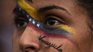 Venezuela i kris. Ett ansikte med texten Venezuela.