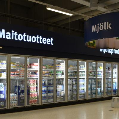 Mjölkhylla i mataffär