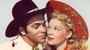 Howard Keel ja Betty Hutton elokuvan Annie mestariampuja mainoskuvassa