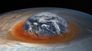 Den stora röda fläcken på Jupiter, med jorden insatt som referens.
