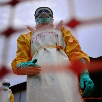 Medecins Sans Frontieres (MSF) medical staff wearing protective clothing treat the body of an Ebola victim at their facility in Kailahun, on August 14, 2014. Kailahun along with the Kenema district is at the epicentre of the worst epidemic of Ebola since