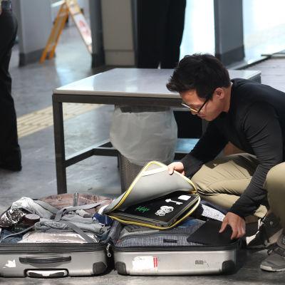 Kappsäck på flygplats