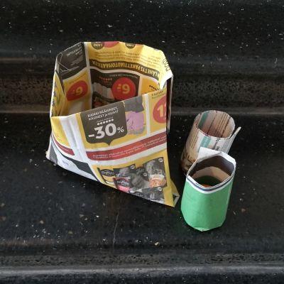 Biojätepussi ja taimipotteja sanomalehdestä taiteltuina