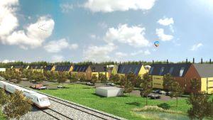Hus vid järnvägen i Sjundeå på planebild.