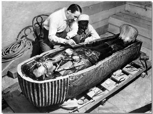 Howard Carter opens the innermost shrine of King Tutankhamen's tomb near Luxor, Egypt which one of carter's water boy found the steps down to.
