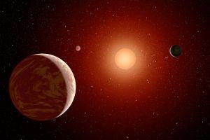 En röd dvärgstjärna med planeter. Det vill säga konstnärens uppfattning av dem.