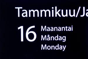 Suurennuskoneen kuva kalenterista, josta näkyy päivämäärä.