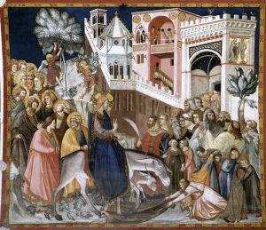 Jeesus ratsastaa aasilla palmusunnuntaina Jerusalemiin. Maalaus (fresko).