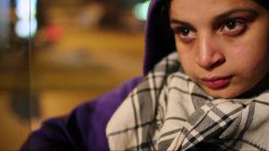Lähikuvassa Amal -tyttö, silmissä surullinen katse