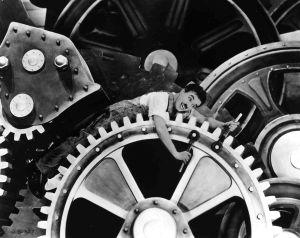 Charlie Chaplin i kugghjulet i filmen Moderna tider.