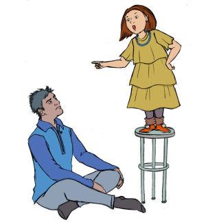 Lapsi opettaa sormi pystyssä isäänsä.
