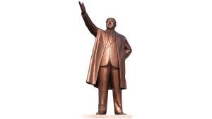 Pohjois-Korean entinen diktaattori Kim Il-Sungin patsas, jossa hän tervehtii kansaa käsi ojossa.