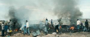 Ghanalaismiehet kaatopaikalla