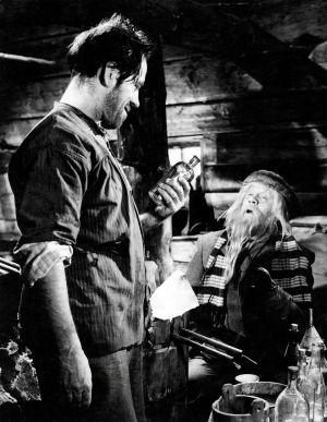 """Kotimainen elokuva """"Ryysyrannan Jooseppi"""". Näyttelijät Heimo Lepistö (Ryysyrannan Jooseppi, Jooseppi Kenkkunen) ja Reino Valkama (Huhmarniemen Ukko-Paavo)."""