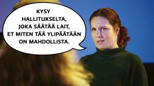 """Pirjo (Pirjo Heikkilä) puhuu nuorelle naiselle, joka on hakenut tuotantoassistentiksi. Pirjon puhekulpa: """"Kysy hallitukselta, joka säätää lait, et miten tää ylipäätään on mahdollista."""""""