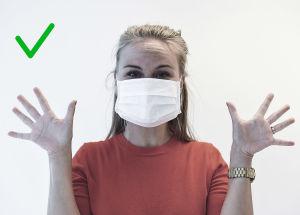 Bild på rätt sätt att bära munskydd. Man ska inte röra i munskyddet medan det används.