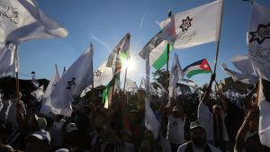 Både radikala och konservativa muslimer har stärkts i Jordanien under de senaste åren. Här firar medlemmar av det Islamiska aktionspartiet sina kandidater inför parlamentsvalet den 20 september
