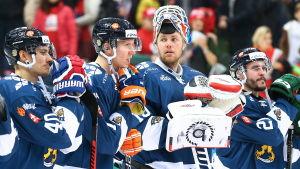 Finländska hockeyspelare efter förlusten mot Ryssland i Moskva.