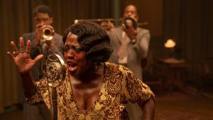 "Chadwick Boseman as Levee,Viola Davis as Ma Rainey and Colman Domingo as Cutler in the musical drama ""Ma Rainey's Black Bottom"""