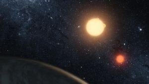 Artistvision av planeten Keplar-16b med två solar.