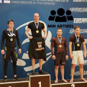 Vitali Sergeev, Jaakko Vilander, Jarmo Petäjäjärvi och Toni Toivanen på en prispall.
