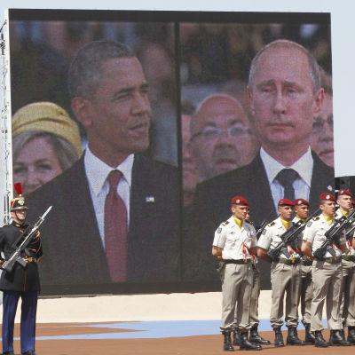 Barack Obama och Vladimir Putin under 70-årsdagen av landstigningen i Normandie