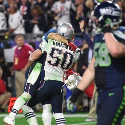 New England Patriotsin pelaajat juhlivat.