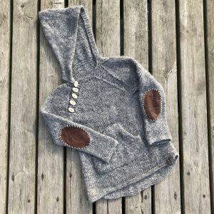 Korjattu neulepusero