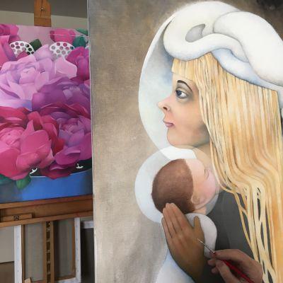 En målning av en mamma med sitt barn.