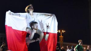 Oppositionsanhängare demonstrerar mot landets omtvistade presidentval i Belarus huvudstad Minsk den 18 augusti.