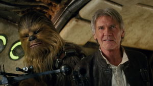 Harrison Fords Han Solo poserar med Chewbacca.