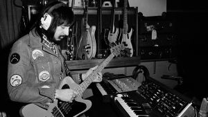 Rockin klassikkolevyt: The Who/Tommy. John Entwistle of The Who playing one of his 'Fenderbird' custom bass guitars in front of a Minimoog synthesiser in his home recording studio in 1972 in England.