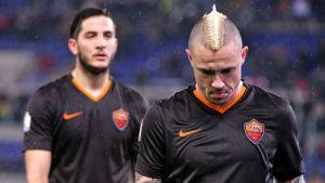 Besvikna AS Roma-spelarna Kostas Manolas och Radja Nainggolan.