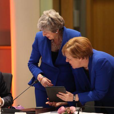 Donald Tusk, Theresa May och Angela Merkel