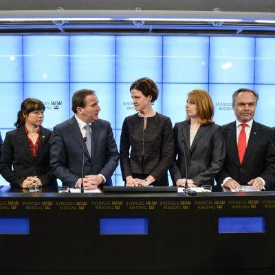 Presskonferens hos Sveriges regering i december 2014.